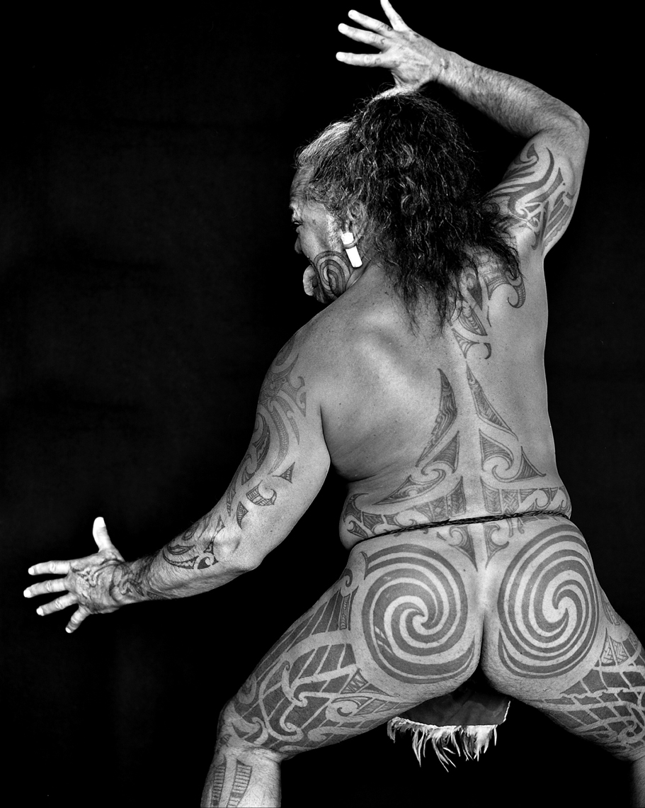 Axel Bernstorff, Fine example of moko (Maori tattoo) from the NgaPuhi tribe of Aotearoa New Zealand, during a haka. The koru (spiral) depicts new beginnings, growth and harmony, taken from the symbolism of an unfurled fern leaf. Collectable fine photographic prints. Culture. Heritage. Tradition. Moko, Aotearoa New Zealand
