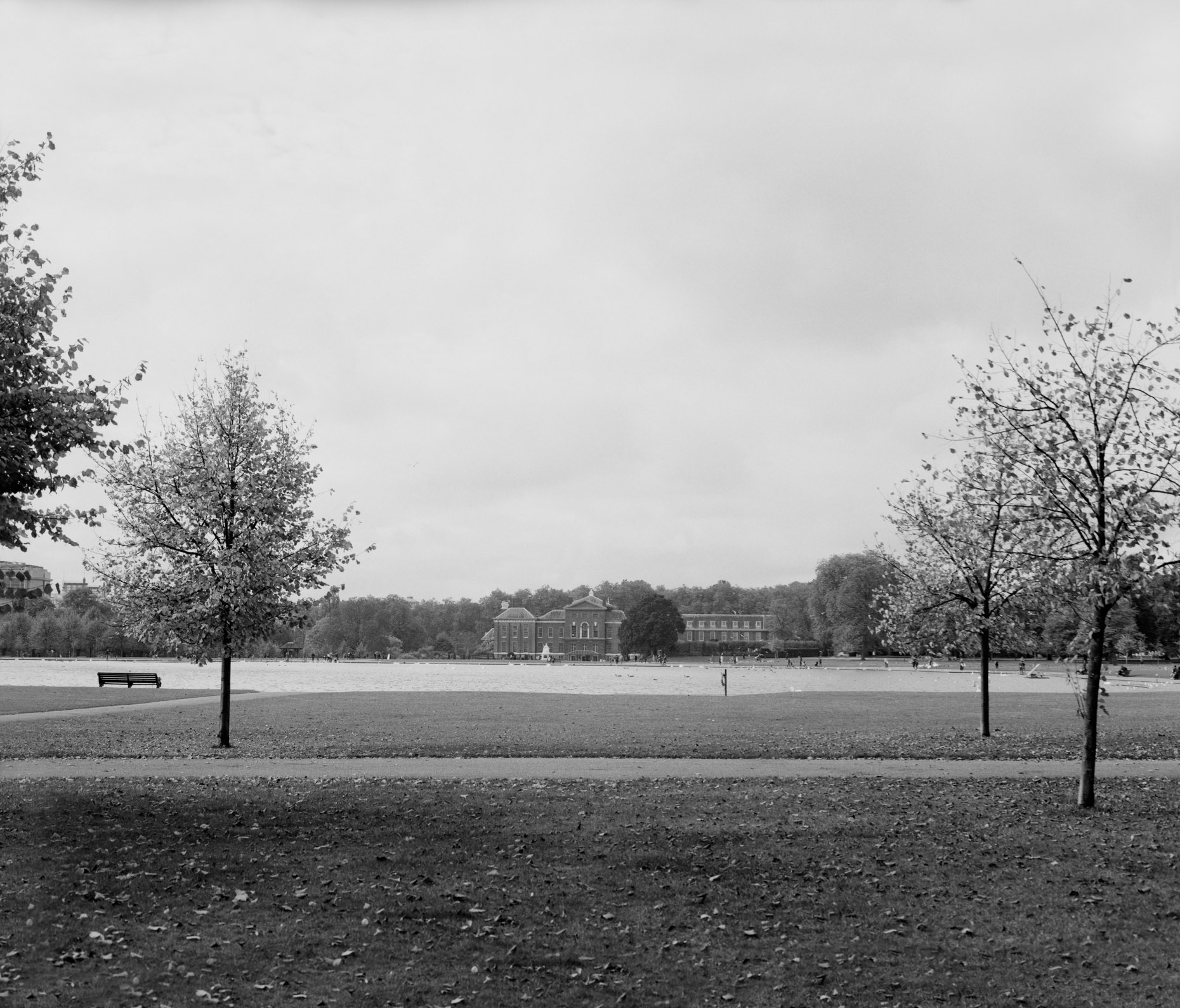 Axel Bernstorff, Collectable limited edition fine photographic art prints. View across the Round Pond to Kensington Palace. Royal Residence in the Royal Borough of Kensington and Chelsea in London, England.